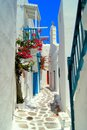 Picturesque greek street whitewashed in the old town of mykonos greece Stock Images