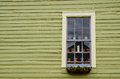 Picturesque house with window and flowerpots wooden wall Royalty Free Stock Photography
