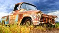Title: Picturesque rural  landscape with old car.