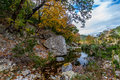 A picturesque scene with beautiful fall foliage on a tranquil babbling brook at lost maples state park in texas an outdoor nature Royalty Free Stock Photos