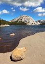 The picturesque shallow lake flat shore of at tioga pass in yosemite park Royalty Free Stock Photo