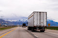 Picturesque straight highway trucks trailers snow capped mountains of Utah Royalty Free Stock Photo