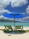 A picturesque umbrella and chaise lounges Royalty Free Stock Photo