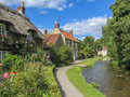 Picturesque village scene complete with river Royalty Free Stock Photography