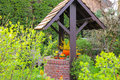 The picturesque well in the spring garden Royalty Free Stock Photo