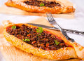 Pide time homemade traditional turkish meal stuffed with meat and sauce Royalty Free Stock Images