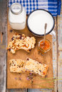 Pie with milk some pieces of apricot jam and on wooden plate Royalty Free Stock Photos