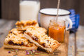 Pie with milk some pieces of apricot jam and on wooden plate Royalty Free Stock Photography