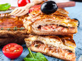 Pie with salmon fish and tomatoes and olives Royalty Free Stock Image