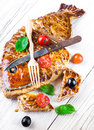 Pie with salmon and tomatoes and olives fish Royalty Free Stock Image