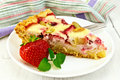 Pie strawberry-rhubarb with sour cream and berries on board Royalty Free Stock Photo