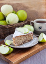 Piece of apple pie with cinnamon homemade and apples on the background Stock Photography