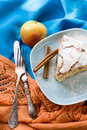 A piece of apple pie lying on blue plate, apple, cinnamon sticks Royalty Free Stock Photo