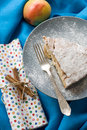 A piece of apple pie lying on blue plate, apple, fork Royalty Free Stock Photo
