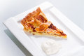 Piece of apple tart and cream Stock Photography