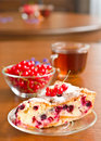 Piece of berry pie on saucer and red currants Royalty Free Stock Photo