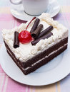 Piece of a black forest cake with cup coffee Stock Photography