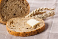 Piece of bread with butter. Royalty Free Stock Photography