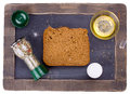 Piece of bread fresh on a chalkboard shot from above Stock Photos