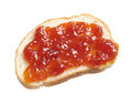 Piece of bread with jam isolated on white background Royalty Free Stock Photo