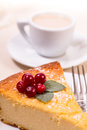 Piece of cake with berries and white coffee Royalty Free Stock Photo