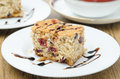 Piece cake dried cranberries nuts decorated chocolate sauce plate Stock Photo