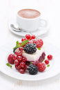 Piece of cake with fresh berries and coffee vertical Royalty Free Stock Image