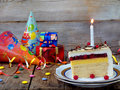 Piece of cake `Napoleon` with lighted candles. Birthday. Side view. Copy space. Royalty Free Stock Photo