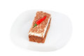 Piece of cake on a plate, and paprika. Royalty Free Stock Photography