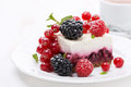 Piece of cheesecake with fresh berries and coffee close up Royalty Free Stock Photo