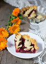 Piece of cherry pie on the wooden table background Stock Photos