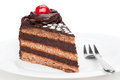 Piece of chocolate cake decorated with cherry.