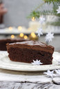 Piece of chocolate cake in white christmas table setting very selective and soft focus Stock Image