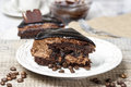 Piece of chocolate cake on wooden table Royalty Free Stock Photos