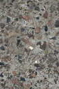 A piece of concrete wall with pebbles Royalty Free Stock Photo