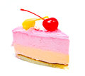 Piece of cream cake with cherry on top isolated a white background Stock Images