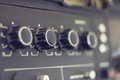 Piece of electrical audio equipment with knobs old retro amplifier selective focus Royalty Free Stock Images