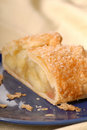 Piece of fresh apple strudel with a flaky crust Royalty Free Stock Images