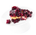 Piece of fresh fruit pie with powdered sugar on white background a plate Stock Image
