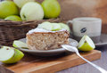 Piece of homemade apple pie with cinnamon and apples on the background Stock Photography