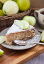 Piece of homemade apple pie with cinnamon and apples on the background Stock Images