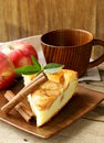 Piece of homemade apple pie with cinnamon on a wooden table Stock Photography