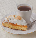 Piece of homemade cake with  meringue and cup of tea Royalty Free Stock Photo