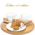 Piece of honey cake on a plate cream and cup of cappuccino wooden board isolated white Royalty Free Stock Images