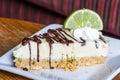 Piece of lemon pie on white dish Stock Photos