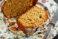 Piece of orange cake with almonds closeup Royalty Free Stock Image