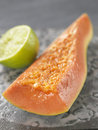 Piece of papaya with lime juice Royalty Free Stock Photography