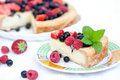 Piece of pie with fresh berries and mascarpone Royalty Free Stock Image