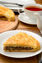 Piece of pie with minced meat on wooden table brown Stock Photos