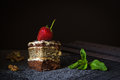Piece of poppy seed cake with strawberry and mint